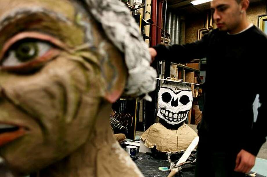 "Fernando Curiel, 20, helps create La Llorona puppet (The Weeping Woman) (left) whose character cries for all children whose education and future are endangered by the budget cuts and negligence in Carlos Baron's theatrical play ""Endangered Species"" on Wednesday Feb. 24, 2010 in San Francisco, Calif. Photo: Jessica Pons, The Chronicle"