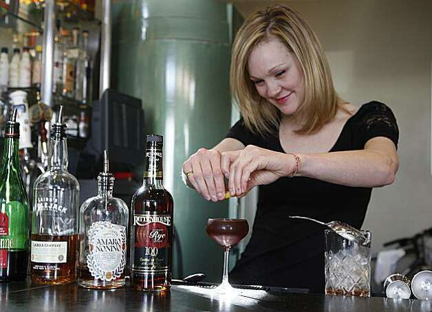 Bartender Brooke Arthur at Range restaurant on Valencia St. in San Francisco, Ca., twisting a lemon for the Bitter Maestro cocktail on Thursday, February 25, 2010. Photo: Liz Hafalia, The Chronicle