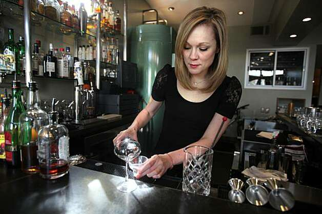Bartender Brooke Arthur at Range restaurant on Valencia St. in San Francisco, Ca., making the Bitter Maestro cocktail on Thursday, February 25, 2010, as she measures ingredients for the drink. Photo: Liz Hafalia, The Chronicle