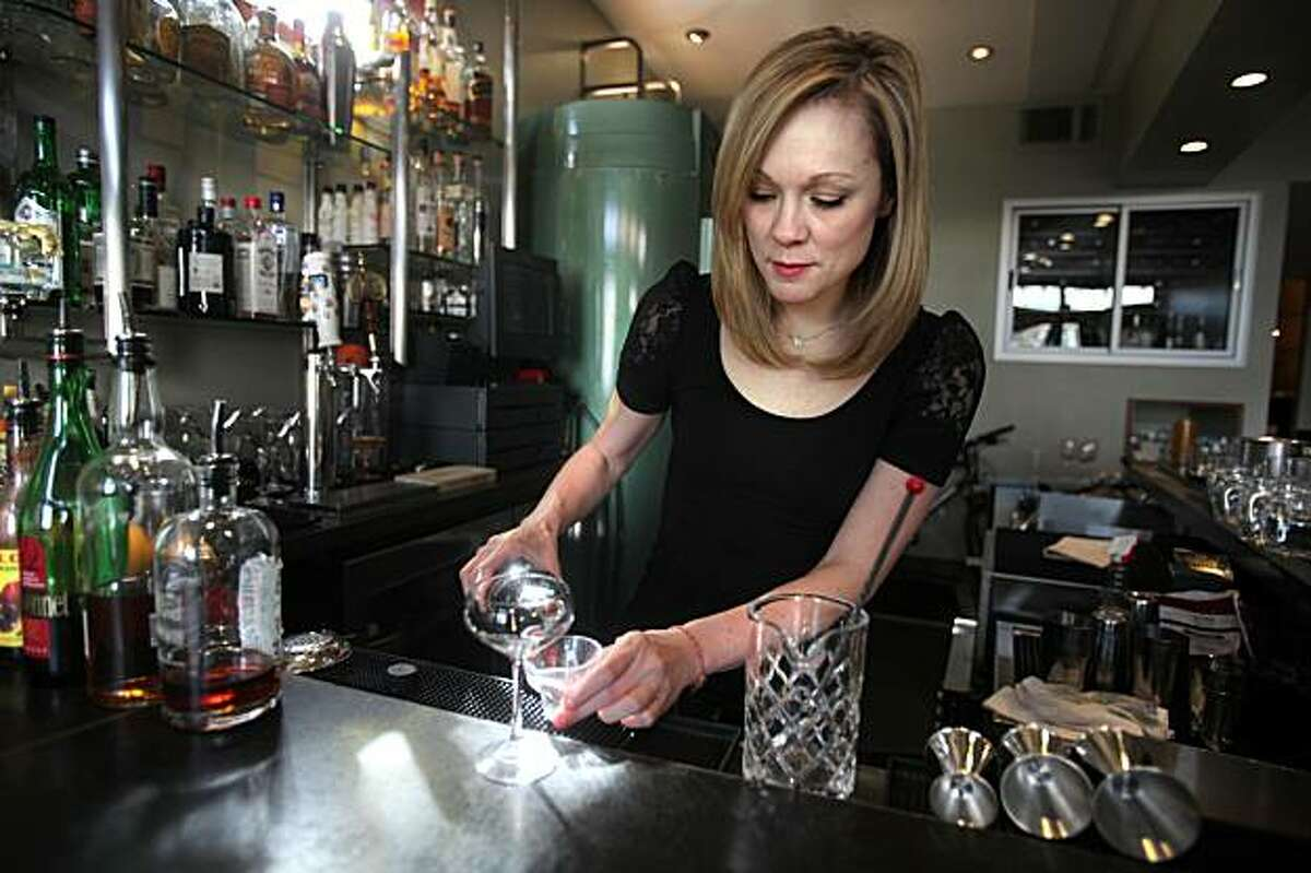 Bartender Brooke Arthur at Range restaurant on Valencia St. in San Francisco, Ca., making the Bitter Maestro cocktail on Thursday, February 25, 2010, as she measures ingredients for the drink.
