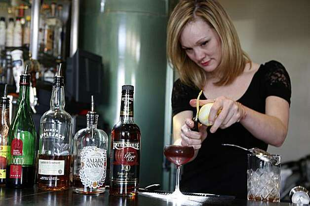 Bartender Brooke Arthur at Range restaurant on Valencia St. in San Francisco, Ca., cutting a lemon peel for the Bitter Maestro cocktail on Thursday, February 25, 2010. Photo: Liz Hafalia, The Chronicle