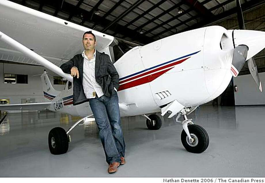 ** FILE ** In this Aug. 16, 2006 file photo, Ed Robertson, frontman for the Barenaked Ladies, poses in front of his plane in Toronto. (AP Photo/The Canadian Press, Nathan Denette) Photo: Nathan Denette 2006, The Canadian Press