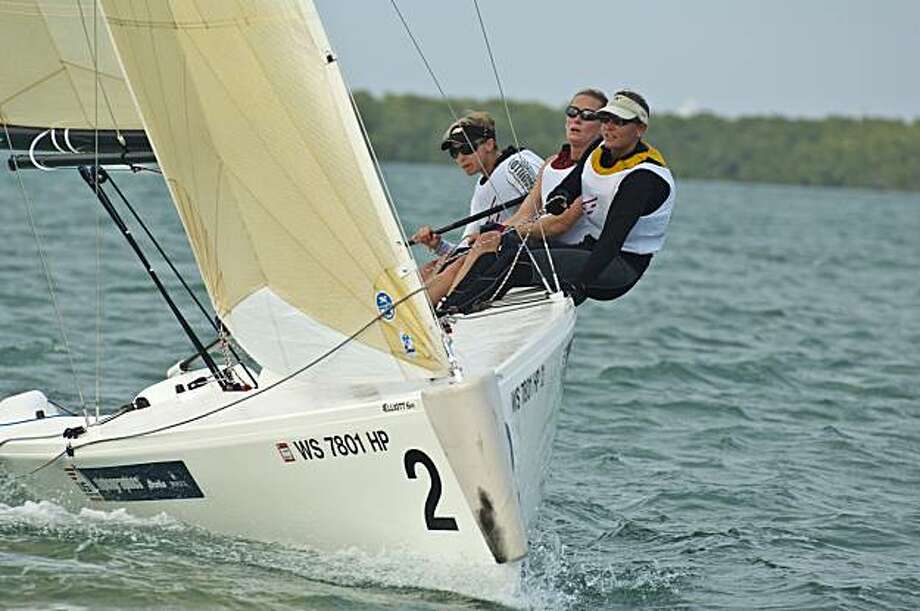 Olympic hopefuls (from back of boat to front of boat) Skipper Genny Tulloch and crew Karina Shelton and Alice Manard sailing in Miami to qualify for the U.S. national sailing team in match racing. Photo: Walter Cooper, U.S. Sailing