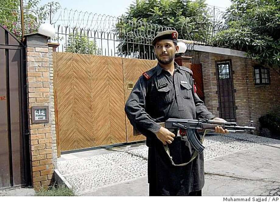A Pakistan's paramilitary soldier stands guard outside the residence of Lynne Tracy, a U.S. diplomat, Tuesday, Aug. 26, 2008 in Peshawar, Pakistan. Gunmen opened fire on the top U.S. diplomat early Tuesday as she left for work in her armored vehicle, police and embassy officials said. No one was killed. (AP Photo/Muhammad Sajjad) Photo: Muhammad Sajjad, AP