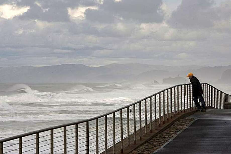 A man watches the waves in Pacifica during Saturday's tsunami advisory that was a result of an 8.8 earthquake in Chile. Photo: David Paul Morris, The Chronicle