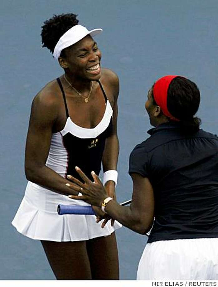 Serena (R) and Venus Williams of the U.S. celebrate after winning their women's doubles final tennis match against Virginia Ruano Pascual and Anabel Medina Garrigues of Spain at the Beijing 2008 Olympic Games August 17, 2008.     REUTERS/Nir Elias (CHINA) Photo: NIR ELIAS, REUTERS