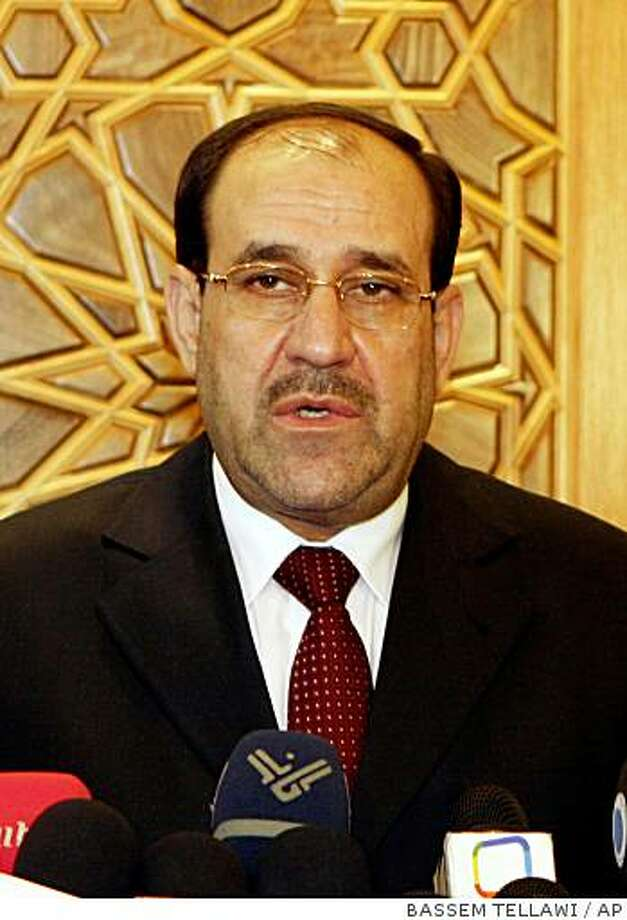 Iraqi Prime Minuister Nouri al- Maliki talks to the reporters after his meeting with Syrian vice president Farouk al -Sharaa Tuesday, Aug. 21, 2007 in Damascus. al-Maliki's three-day sojourn in Syria comes as part of his efforts to seek neighbors' help in stemming the violence ravaging Iraq. He and Syrian President Bashar Assad appeared briefly before cameras before going into a closed meeting Tuesday.(AP Photo/ Bassem Tellawi). Ran on: 08-23-2007 President Bush, left, also offered fresh support at the VFW convention for Prime Minister Nouri al-Maliki, above, calling him a &quo;good man with a difficult job.&quo; Photo: BASSEM TELLAWI, AP