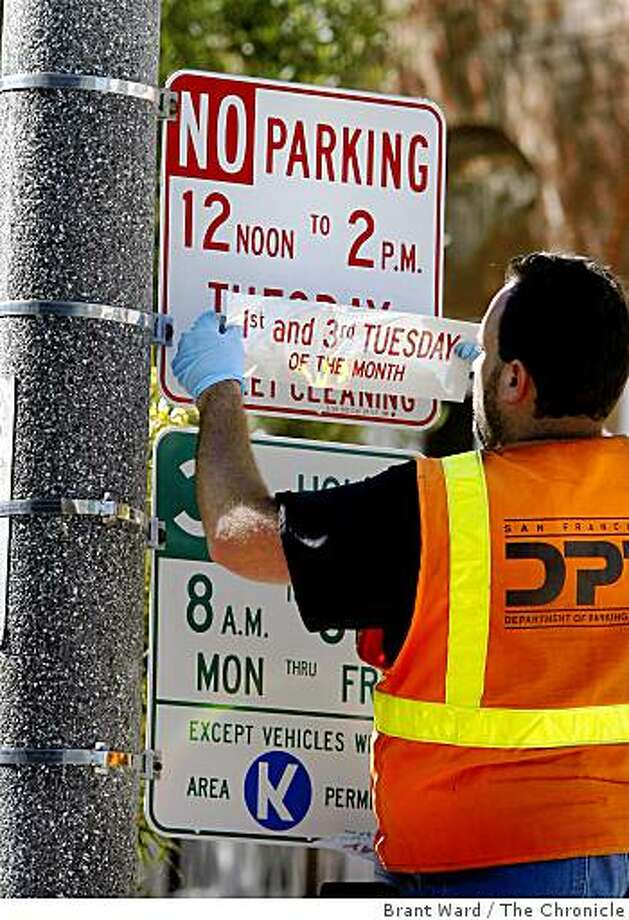 Mike Turner of Dept. of Parking and Traffic changed street sweeping signs Monday August 25, 2008 along Filbert Street near Divisadero.Residents of San Francisco's Marina district who park on the street will get a break as the city scales back weekly street sweeping in many residential neighborhoods. Photo: Brant Ward, The Chronicle