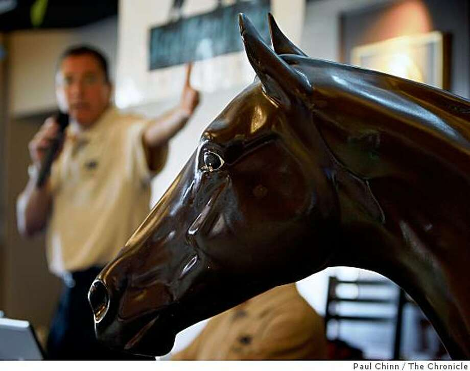 Auctioneer Mark Weitz, left, describes a fiberglass horse that was sold at auction at Bay Meadows Race Track in San Mateo, Calif., on Saturday, Aug. 23, 2008. The horse fetched $1,400 during the first day of the auction. Photo: Paul Chinn, The Chronicle