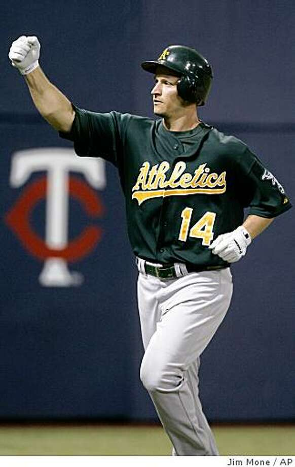 Oakland Athletics' Mark Ellis celebrates after hitting a solo home run off Minnesota Twins' Nick Blackburn in the first inning of a baseball game Monday, Aug. 18, 2008 in Minneapolis. (AP Photo/Jim Mone) Photo: Jim Mone, AP
