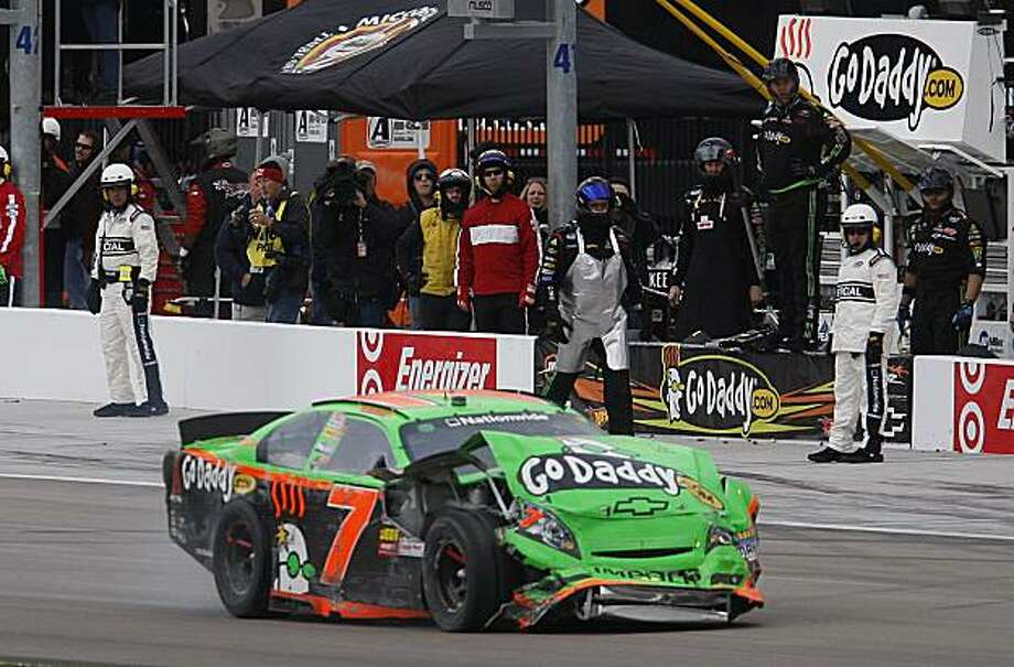 Danica Patrick (7) drives past her crew after crashing during the NASCAR Nationwide Series Sam's Town 300 auto race Saturday, Feb. 27, 2010, in Las Vegas. Photo: Isaac Brekken, AP