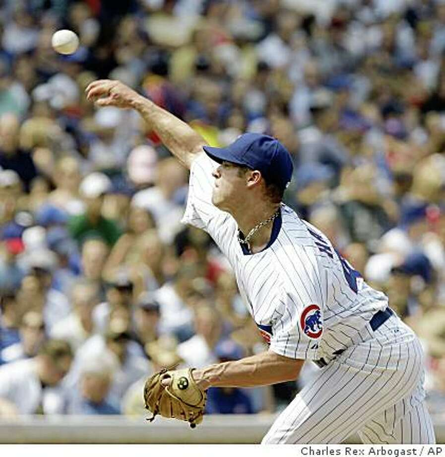 Chicago Cubs starting pitcher Rich Harden delivers during the fourth inning of their baseball game against the Houston Astros at Wrigley Field in Chicago, Tuesday, Aug. 5, 2008. The Cubs won 11-7. (AP Photo/Charles Rex Arbogast) Photo: Charles Rex Arbogast, AP