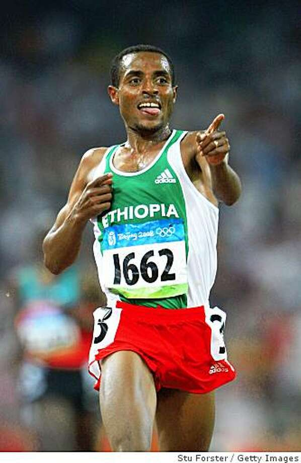 BEIJING - AUGUST 23:  Kenenisa Bekele of Ethiopia celebrates winning the gold medal in the Men's 5000m Final held at the National Stadium on Day 15 of the Beijing 2008 Olympic Games on August 23, 2008 in Beijing, China.  (Photo by Stu Forster/Getty Images) Photo: Getty Images