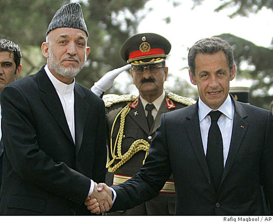 Afghan President Hamid Karzai, left, shakes hand with French President Nicolas Sarkozy at president palace in Kabul, Afghanistan, Wednesday, Aug. 20, 2008. Sarkozy visited a military chapel in Kabul on Wednesday where the bodies of 10 French soldiers killed in battle lay before they were to be flown home.(AP Photo/Rafiq Maqbool) Photo: Rafiq Maqbool, AP