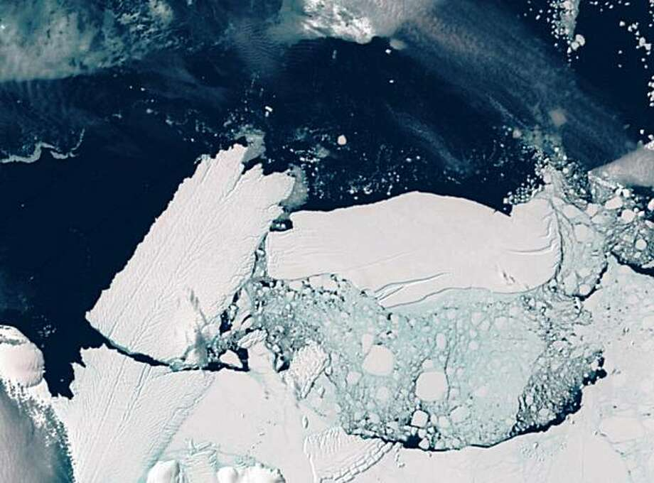 In this satellite image released by Commonwealth of Australia, a 97-kilometer (60 mile) long iceberg known as B9B, right, crashes into the Mertz Glacier Tongue, left, in the Australian Antarctic Territory on Feb. 20, 2010. The collision created a new 78-kilometer (48 mile) long iceberg. Photo: AP
