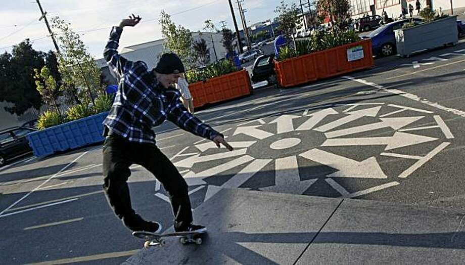 "A skateboarder glides across a stone bench at Showplace Triangle Plaza. One of the new ""parklets"" being built around San Francisco. Ripping out old parking spaces and putting in mini-public plazas in their place create these new additions to the urban landscape. Wednesday Feb. 24, 2010. Photo: Lance Iversen, The Chronicle"