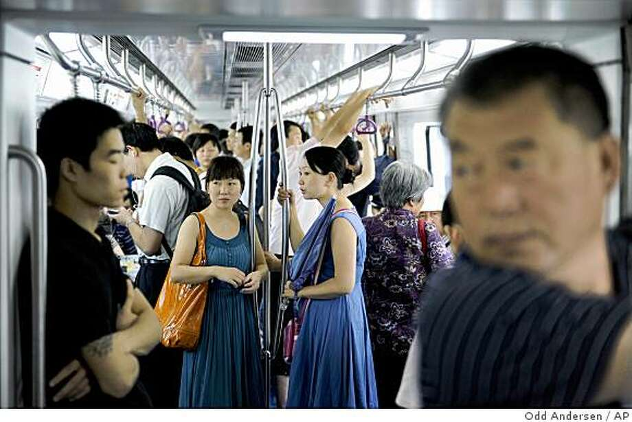 """We will use the subway as much as possible, as it's the quickest way to get around and above-ground traffic is horrendous.""Locals take a ride in a subway train in Beijing, Tuesday, Aug. 19, 2008.  (AP Photo/Odd Andersen) Photo: Odd Andersen, AP"