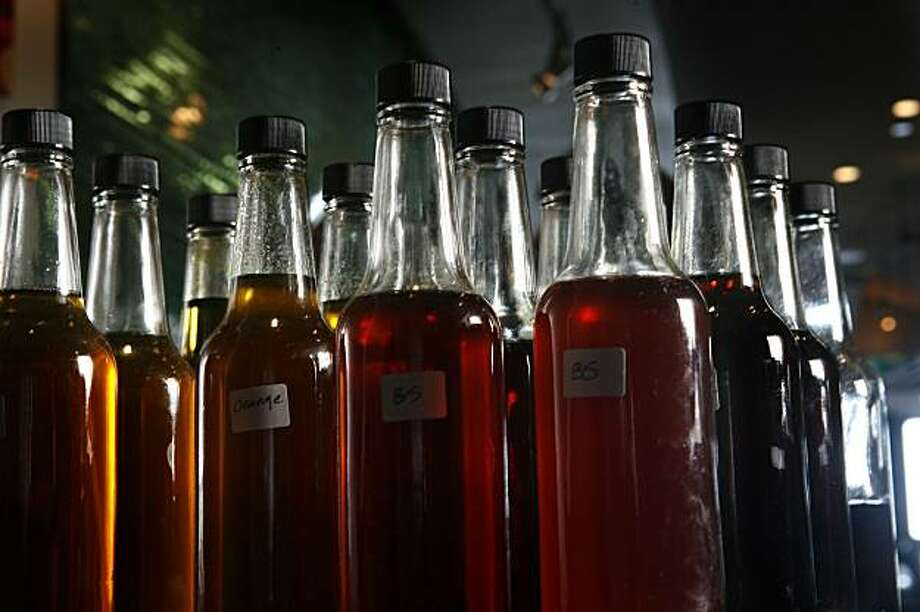 BITTERS12_0089_KW_.jpg Botteles of bitters; distilled herbs, roots, barks and plants hand made by  bartender Jennifer Colliau  (NOT PICTURED) at the Slanted Door on the Embarcadero in San Francisco on January 2, 2007 for the photographer.  Kat Wade/The Chronicle  Ran on: 01-19-2007 Photo: Kat Wade, The Chronicle