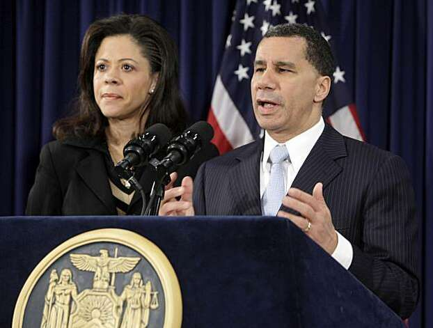 New York Gov. David Paterson, accompanied by is wife Michelle, speaks at a news conference in New York,  Friday, Feb. 26, 2010, where he  officially ended his election bid, citing an accumulation of distractions, but saying he had never abused his office. Photo: Richard Drew, AP