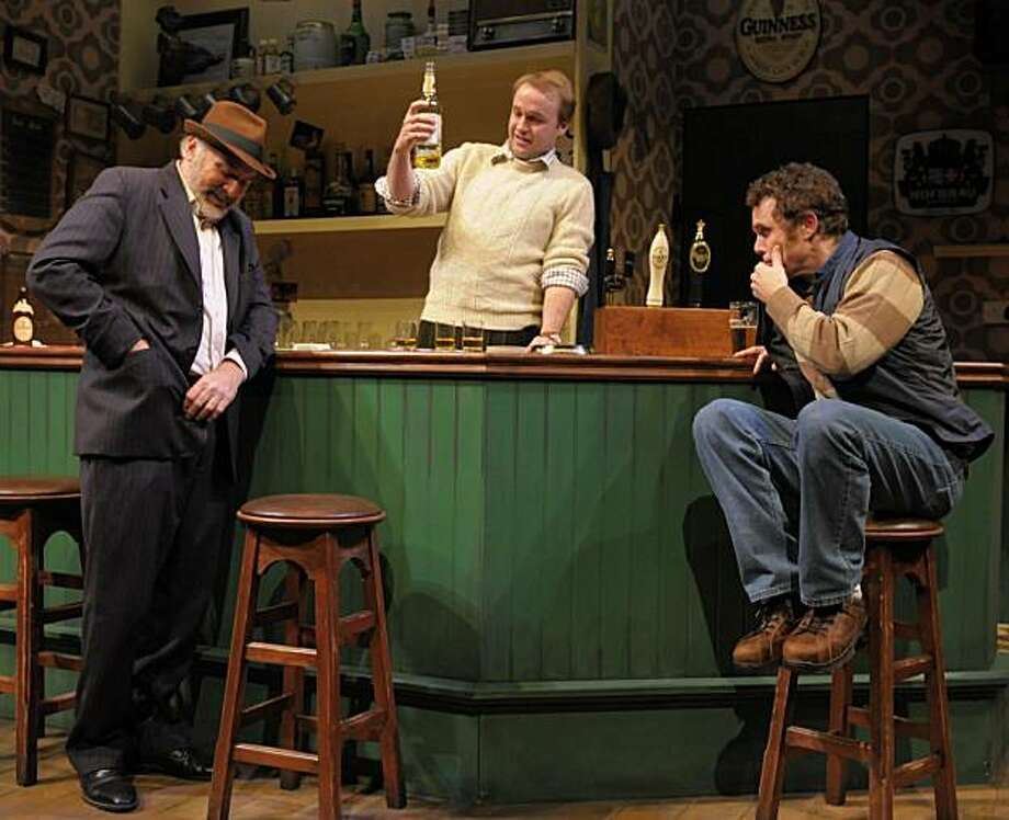 """Robert Sicular (left), bartender Alex Moggridge and Mark Anderson Phillips settle in for some serious drinking in """"The Weir"""" at San Jose Rep. But what's really in those bottles and glasses? Photo: Kevin Berne"""