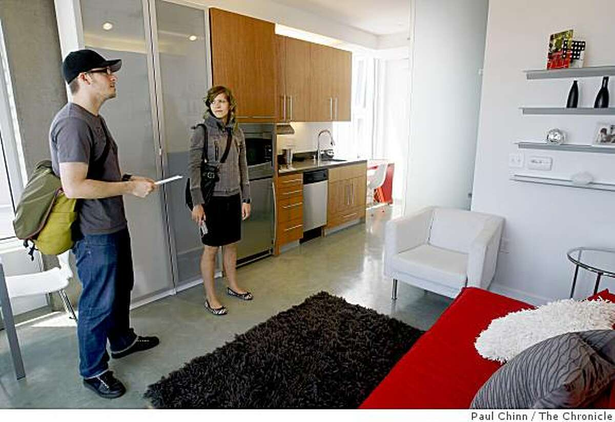 Alex Masse and Marie Eve Primeau visit one of the models at the Cubix Yerba Buena studio condominiums in San Francisco, Calif., on Friday, Aug. 22, 2008. Each of the 98 units have no more than 350 square feet of living space.