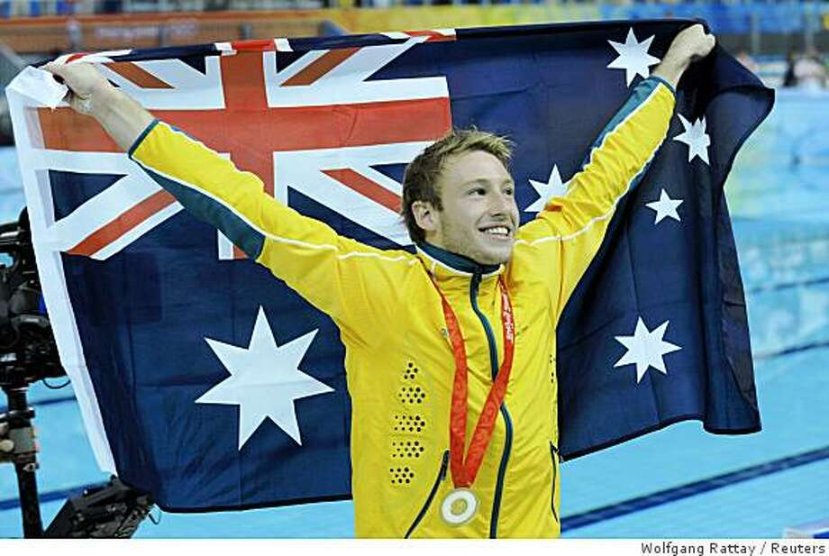 Matthew Mitcham of Australia celebrates with his country's flag after winning the gold medal for the men's 10m platform diving final at the Beijing 2008 Olympic Games August 23, 2008. Photo: Wolfgang Rattay, Reuters
