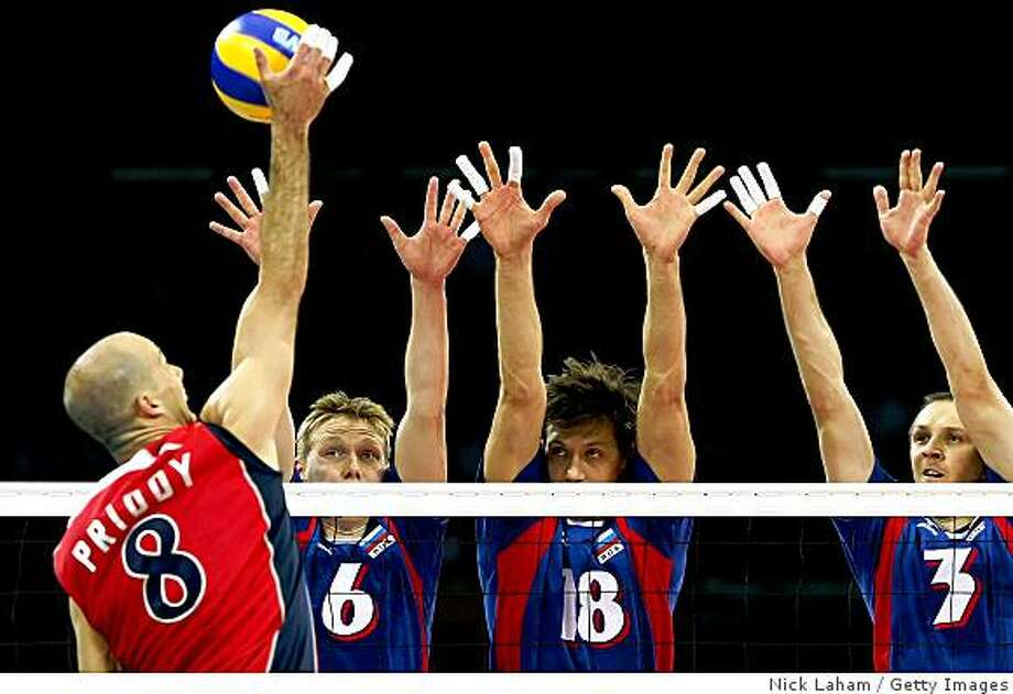 BEIJING - AUGUST 22:  William Priddy #8 of the United States goes up for a spike over Sergey Grankin #6, Alexey Kuleshov #18 and  Alexander Kosarev #3 of Russia during the semifinal volleyball game at the Capital Indoor Stadium on Day 14 of the Beijing 2008 Olympic Games on August 22, 2008 in Beijing, China.  (Photo by Nick Laham/Getty Images) Photo: Getty Images