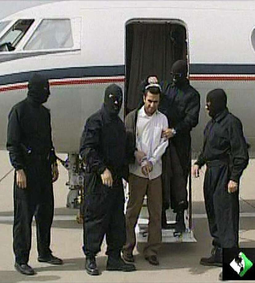 "An image grab taken on February 23, 2010 from Iranian local TV station IRIB, shows Iran's top Sunni militant Abdolmalek Rigi (C) upon his return to Tehran following his arrest. Iran said it arrested Rigi, the alleged mastermind of several deadly bombings,on a flight to Dubai only 24 hours after he was at a US militarly base in Afghanistan, in what it hailed as a ""defeat"" for its Western arch-foes. Photo: -, AFP/Getty Images"