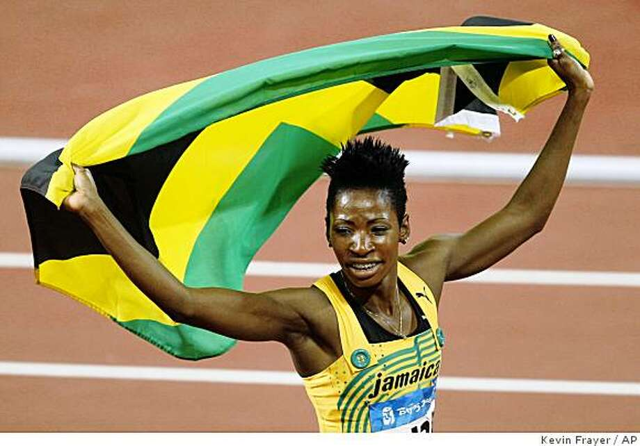 Jamaica' Melaine Walker celebrates winning the gold in the women's 400-meter hurdles final during the athletics competitions in the National Stadium  at the Beijing 2008 Olympics in Beijing, Wednesday, Aug. 20, 2008. Photo: Kevin Frayer, AP
