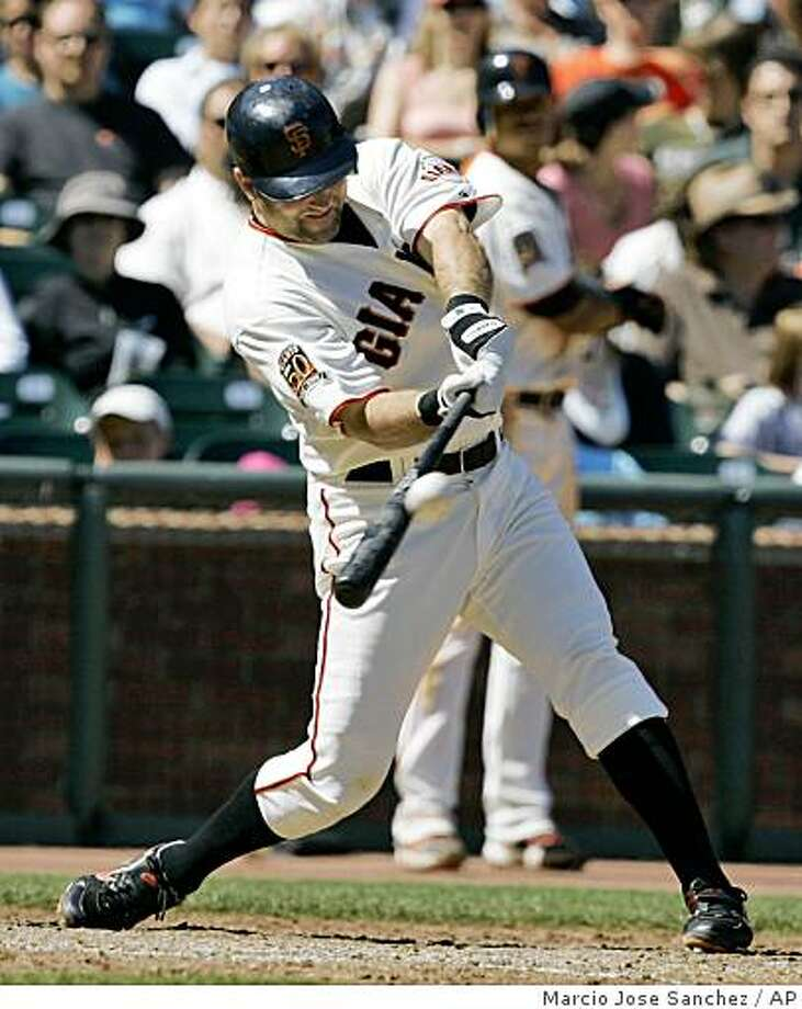 San Francisco Giants' Rich Aurilia drives in the game-winning run with a triple off San Diego Padres relief pitcher Mike Adams in the eighth inning of a baseball game in San Francisco, Saturday, Aug. 23, 2008. San Francisco won 4-3. (AP Photo/Marcio Jose Sanchez) Photo: Marcio Jose Sanchez, AP