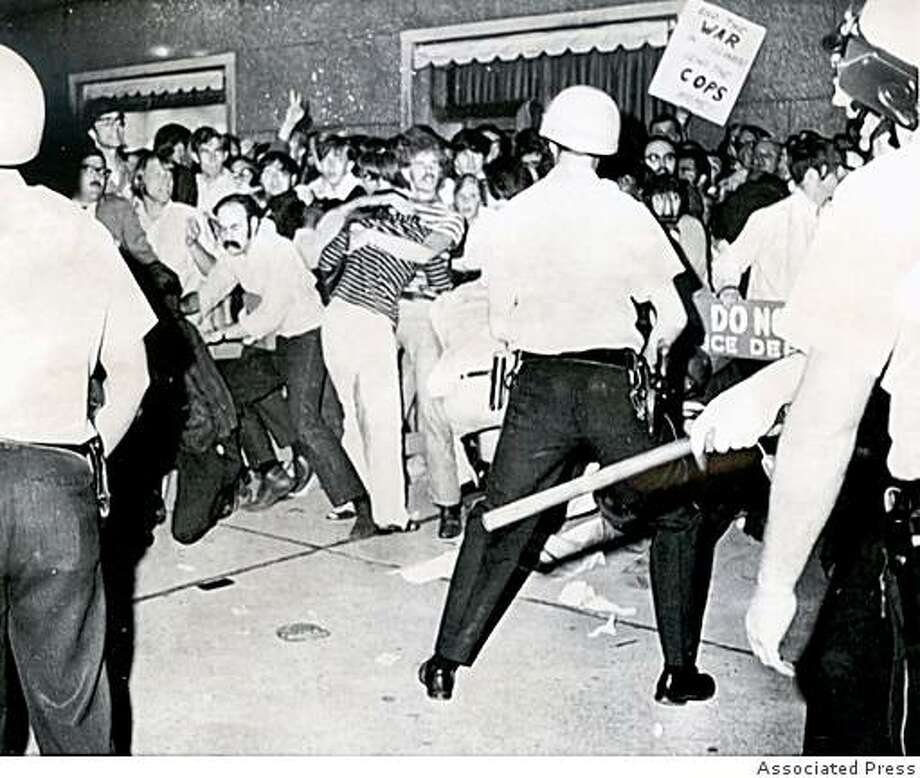 Police wade into a large group of demonstratorson on Micihigan Avenue near the Hilton Hotel, the headquarters hotel for the Democratic National Convention in Chicago, August 28, 1968. / Associated Press Photo: Associated Press