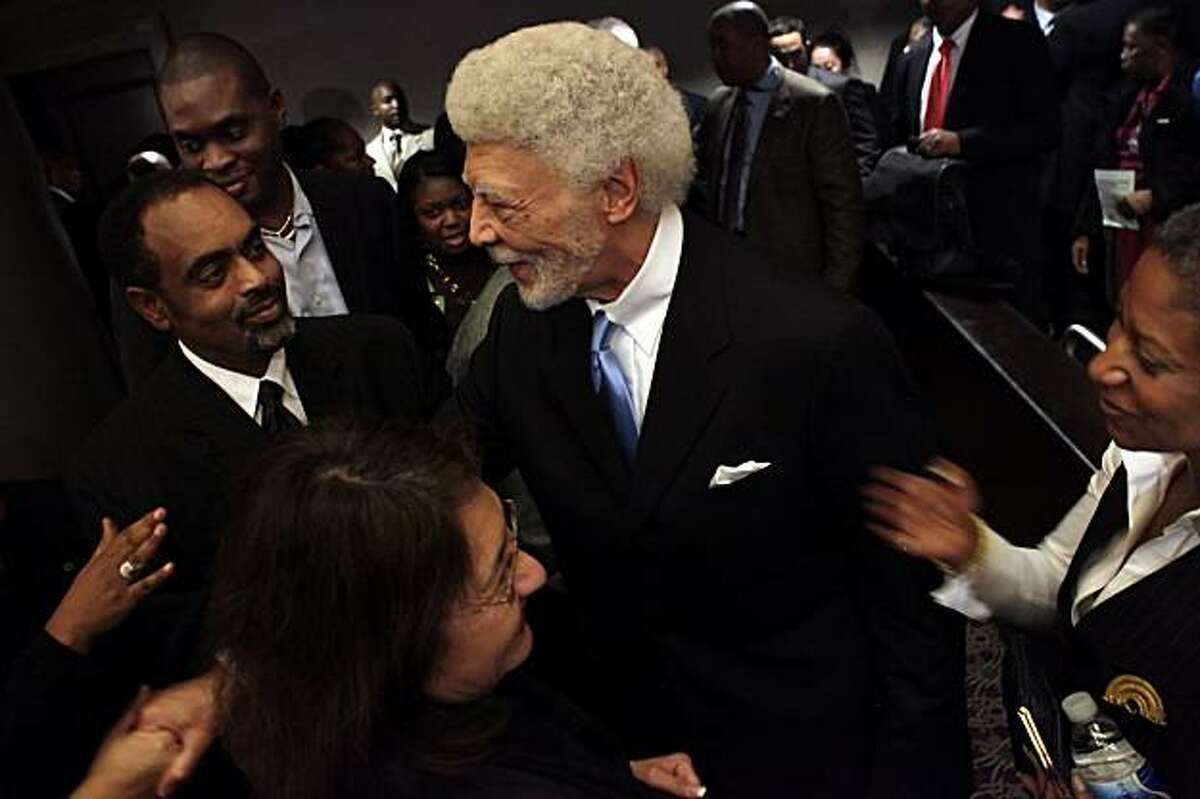 Oakland Mayor Ron Dellums and his wife Cynthia greet people after the state of the city speech to hundreds, Monday Feb. 22, 2010, in Oakland, Calif. In his speech he spoke of how the cities crime rate has dropped, the creation of hundreds of jobs and thanks his staff and the citizens of Oakland.
