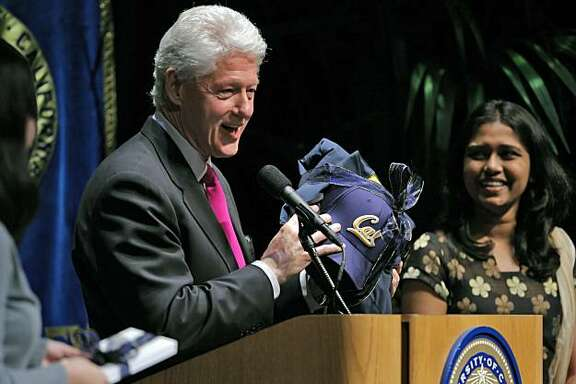 "Former President Bill Clinton is all smiles when he receives some Cal souvenirs after delivering his, ""Global Citizenship: Turning Good Intentions into Positive Action"" speech to the UC Berkeley community at Zellerbach Hall at the UC Berkeley campus in Berkeley, Calif., on Wednesday, February 24, 2010."