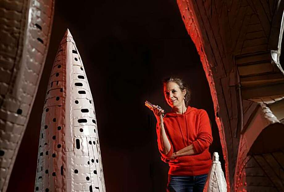 Ann Weber, the artist in residence at the deYoung Museum stands in the middle of her sculptor, Thursday Feb. 4, 2010, in San Francisco, Calif. Weber is a Bay Area sculptor who takes ordinary cardboard and turn it into towering shapes, some as tall as 16 feet. Photo: Lacy Atkins, The Chronicle
