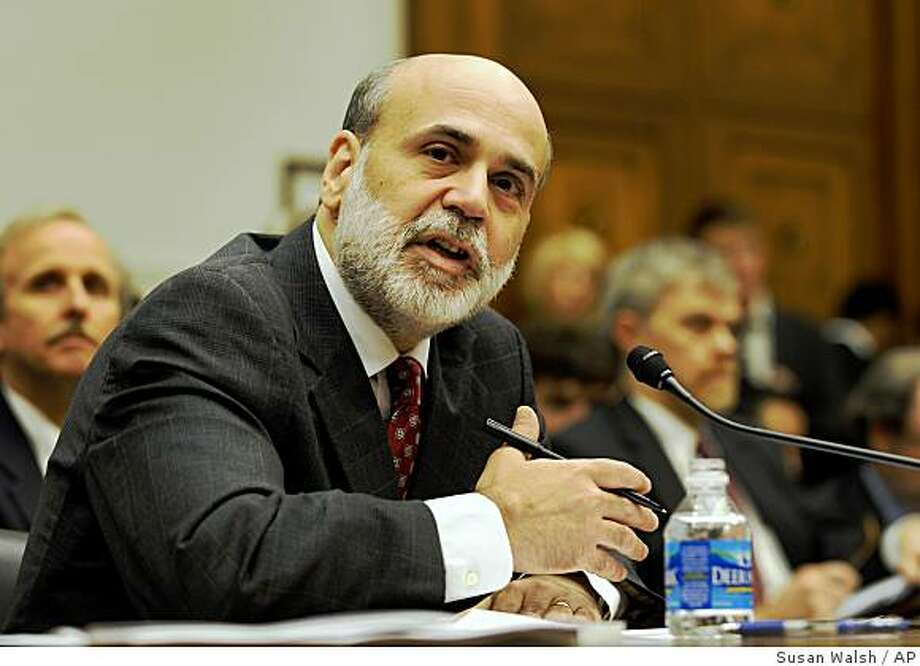 **FILE** In this July 16, 2008 file photo, Federal Reserve Chairman Ben Bernanke testifies before the House Financial Services Committee hearing on Capitol Hill in Washington.  The Fed's handling of the credit, financial and housing debacles  _ which have badly burned the economy _ is likely to spur debate at a high-profile conference beginning Thursday, Aug. 21, 2008, in Jackson Hole, Wyo. (AP Photo/Susan Walsh, file) Photo: Susan Walsh, AP