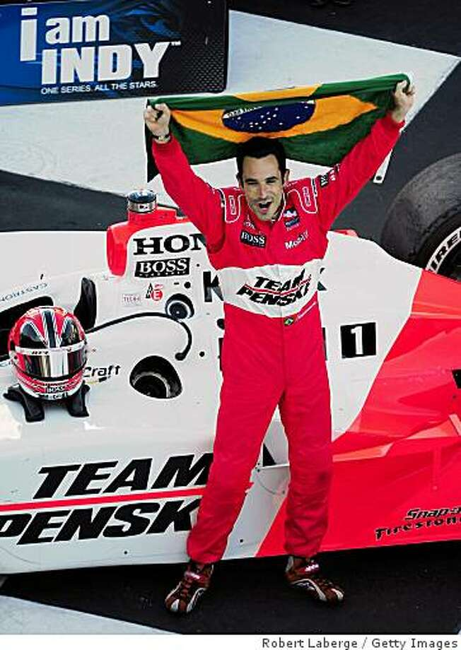 SONOMA, CA - AUGUST 24:  Helio Castroneves of Brazil driver of the #3 Team Penske Dallara Honda celebrates after winning the IndyCar Series PEAK Antifreeze & Motor Oil Indy Grand Prix of Sonoma County at the Infineon Raceway on August 24, 2008 in Sonoma, California.  (Photo by Robert Laberge/Getty Images) Photo: Getty Images