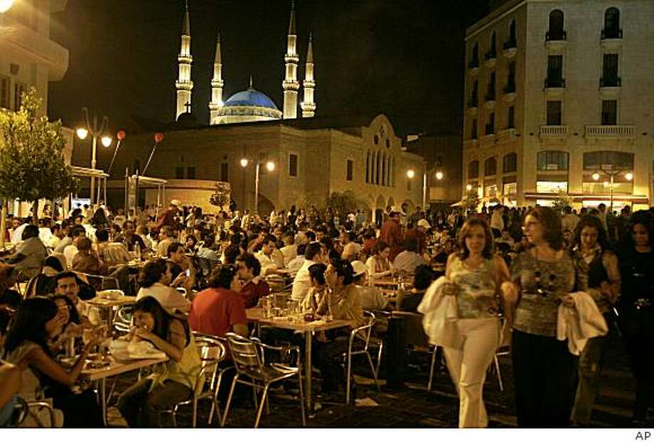 **APN ADVANCE FOR SUNDAY AUG. 24** Tourists eat at restaurants in downtown Beirut, Lebanon, Thursday, Aug. 7, 2008. After three years of wars, assassinations and back-to-back crises Lebanon seems to be on a roll again, in a big way. Only three months ago, this tiny Arab nation of four million and its 18 sects were thought to be on the brink of civil war and eventual breakup. (AP Photo) Photo: AP