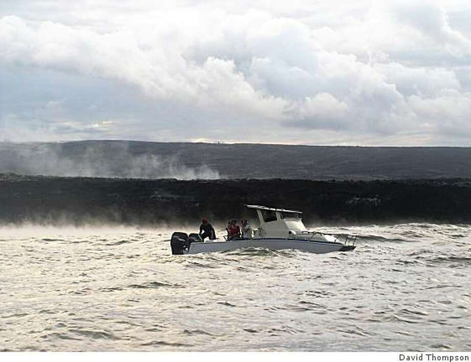 The sea boils as molten lava flows in from the Big Island's active volcano, providing a sizzling close-up to visitors in boats. Photo: David Thompson