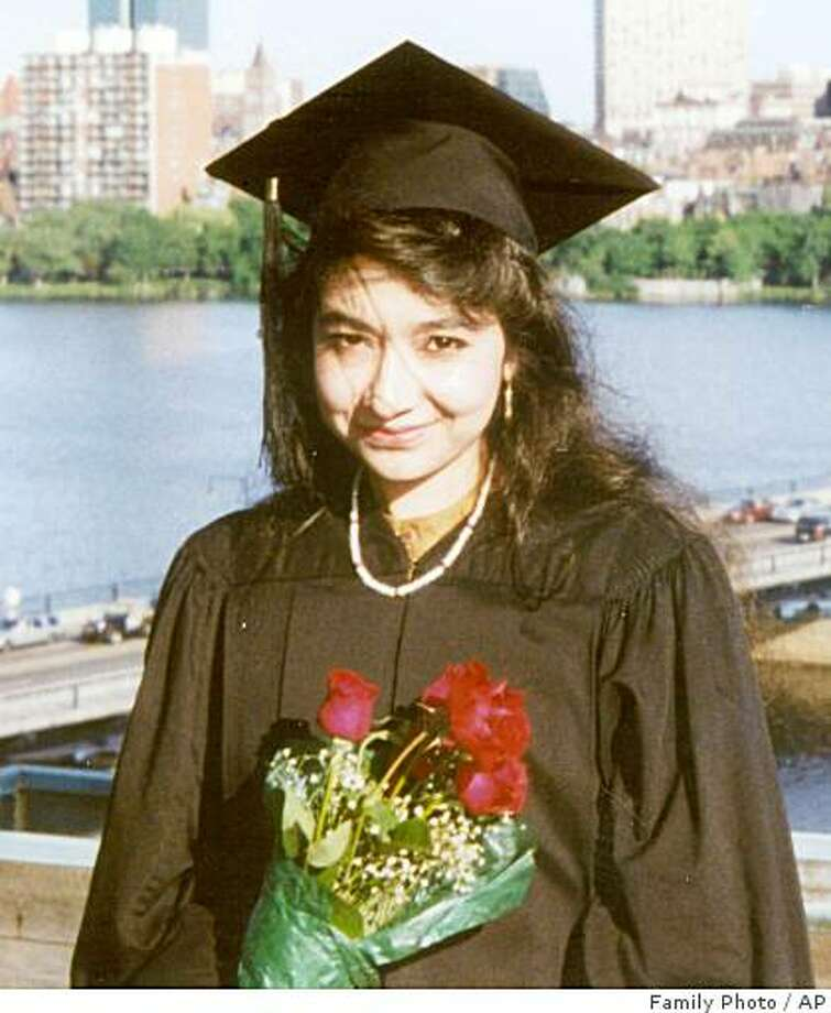"In this undated photo provided by the law firm Whitfield, Sharp and Sharp, Aafia Siddiqui is shown after her graduation from Massachusetts Institute of Technology. Siddiqui, 36, is recovering in federal custody in New York from bullet wounds she sustained in Afghanistan in July 2008. Arrested outside an Afghan governor's compound, authorities allege she was carrying bottles and jars of chemicals, papers describing U.S. landmarks, and instructions on how to make chemical weapons. Prosecutors say she was shot by a U.S. Army officer after she grabbed his Army M-4 rifle from the floor and pointed it at an Army captain, crying ""Allah Akbar!"" (AP Photo/Family Photo via Whitfield, Sharp and Sharp) **NO SALES** Photo: Family Photo, AP"