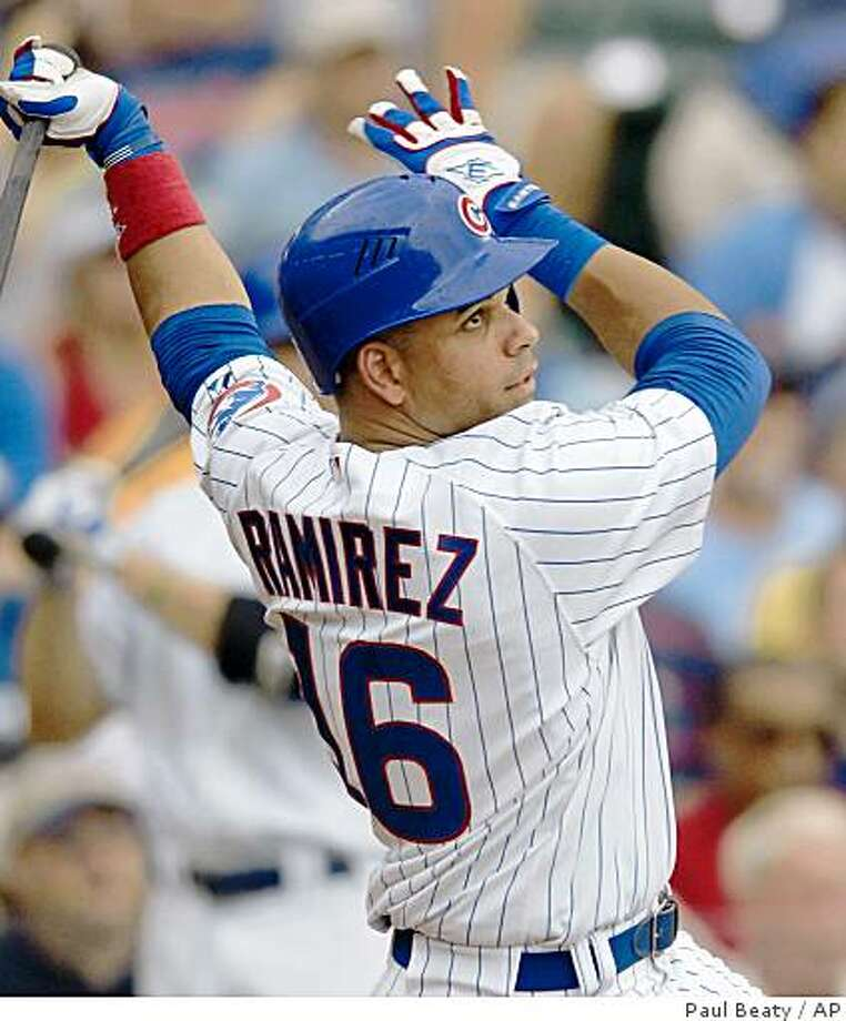 Chicago Cubs' Aramis Ramirez watches his second three-run home run against the Washington Nationals in the eighth inning of a baseball game in Chicago, Saturday, Aug. 23, 2008.  (AP Photo/Paul Beaty) Photo: Paul Beaty, AP