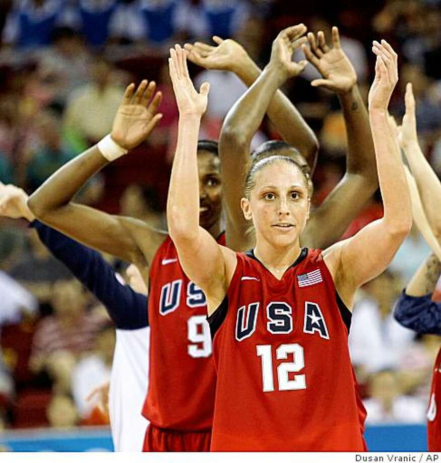 Team USA's Diana Taurasi (12) celebrates after defeating Russia in a women's semifinal basketball game at the Beijing 2008 Olympics in Beijing,  Thursday, Aug. 21, 2008. Photo: Dusan Vranic, AP