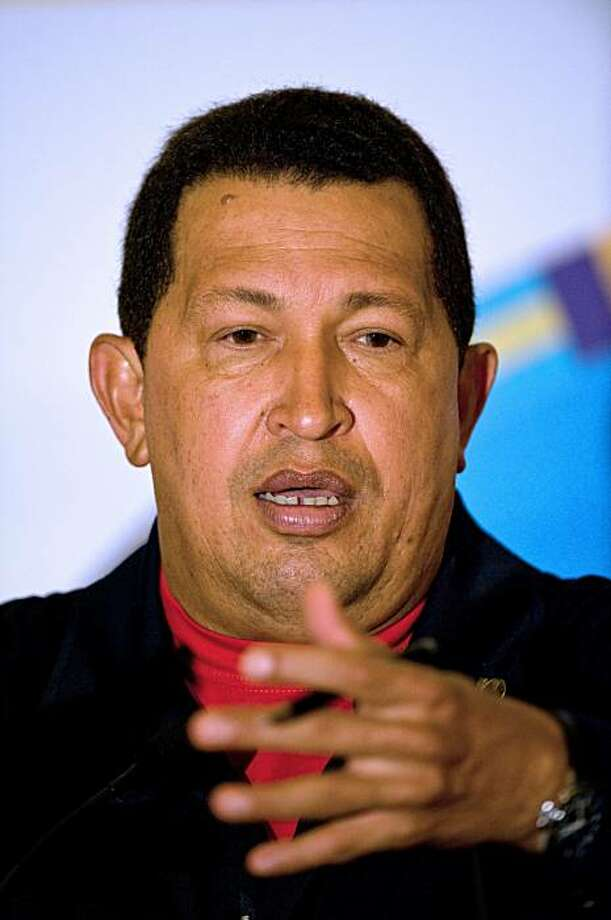 Venezuelan President Hugo Chavez gestures as he delivers a press conference after the closing of the Rio Group summit and the Caribbean Community (Caricom) meeting on February 23, 2010 in Playa del Carmen, Mexico. Latin American and Caribbean leaders Tuesday agreed to create a new bloc without the United States and Canada, and swiftly called for fresh talks on the sovereignty of the Falklands Islands. The announcement of the new bloc followed a clash Monday between leftist Venezuelan President Hugo Chavezand conservative Colombian President Alvaro Uribe during a private meeting, highlighting deep left-right divides. Photo: Ronaldo Schemidt, AFP/Getty Images