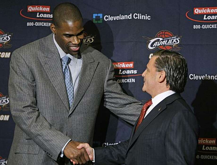 Cleveland Cavaliers' Antawn Jamison, left, shakes hands with owner Dan Gilbert before a news conference Thursday, Feb. 18, 2010, in Cleveland. The best team in the league filled its last glaring hole when general manager Danny Ferry acquired Jamison Wednesday in a three-team trade with Washington and Los Angeles. Jamison's ability to shoot from the perimeter should create more space inside for Shaquille O'Neal and LeBron James. Photo: Tony Dejak, AP