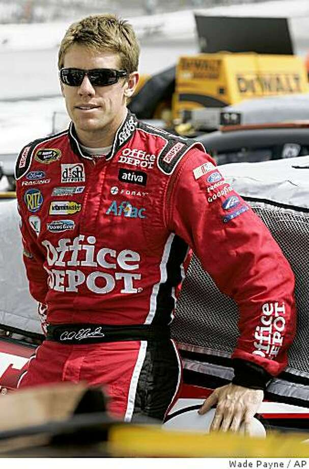 Carl Edwards relaxes before the qualifying race for the NASCAR Sprint Cup Series Sharpie 500 at Bristol Motor Speedway Friday, Aug. 22, 2008, in Bristol, Tenn. Photo: Wade Payne, AP