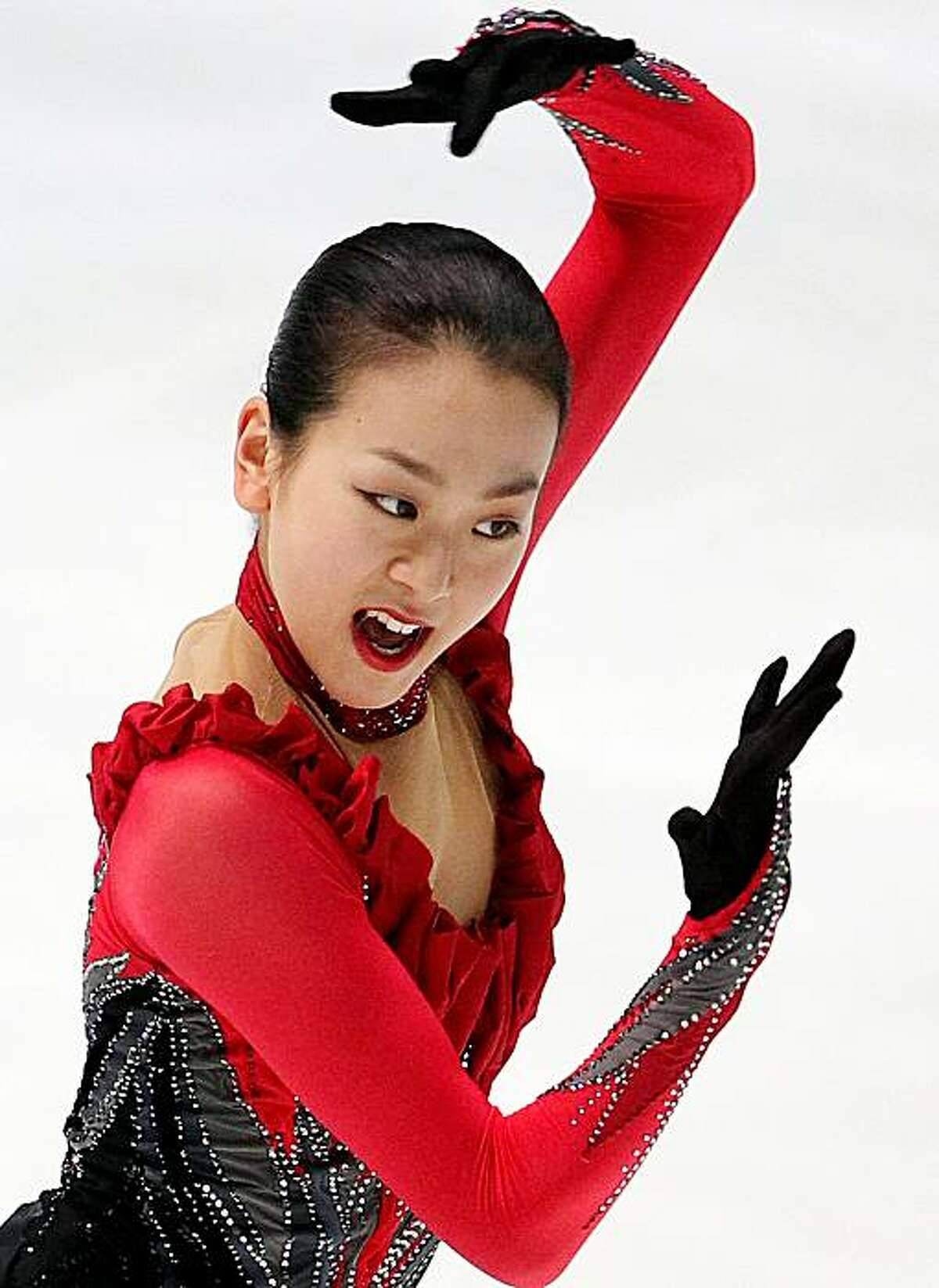 Mao Asada of Japan performs on her way to winning the gold medal during the ladies free skating event at the Japan National Figure Skating Championships in Osaka, western Japan, Sunday, Dec. 27, 2009.