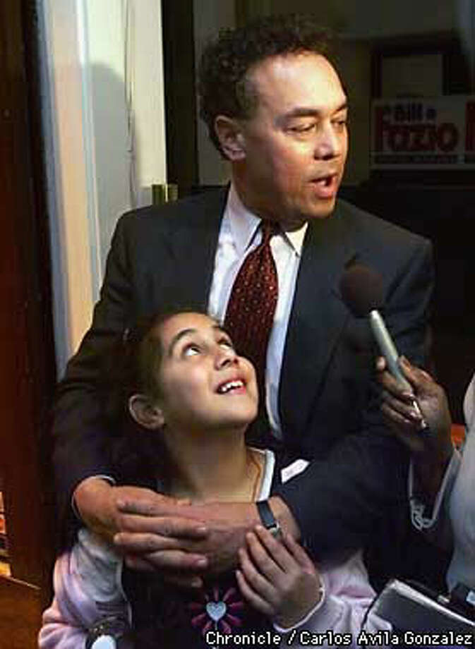 Tatiana Fazio smiles as her father, Bill Fazio, is interviewed by the media. Preliminary results show him with the lead in the election for District Attorney of San Francisco. Chronicle Photo by Carlos Avila Gonzalez