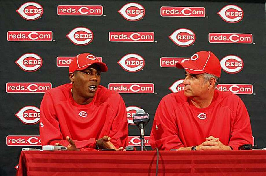GOODYEAR, AZ - FEBRUARY 22: Pitcher Aroldis Chapman #54 (L) of the Cincinnati Reds speaks with the media as Class A pitching coach Tony Fossas (R) acts as an interpreter during a press conference at the Cincinnati Reds Development Complex on February 22,2010 in Goodyear, Arizona. Photo: Hunter Martin, Getty Images