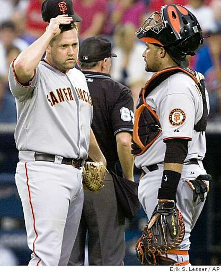 San Francisco Giants pitcher Matt Palmer, left, speaks with his catcher Bengie Molina after hitting Atlanta Braves batter Yunel Escobar in the first inning of a baseball game on Saturday, Aug. 16, 2008, in Atlanta. (AP Photo/Erik S. Lesser) Photo: Erik S. Lesser, AP