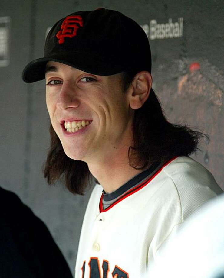 FILE - In tis Sept. 27, 2009, file photo, San Francisco Giants pitcher Tim Lincecum smiles in the dugout before a baseball game against the  Chicago Cubs  in San Francisco. Lincecum and the Giants reached a preliminary agreement on a $23 million, two-yearcontract ahead of the scheduled start of an arbitration hearing. The agreement is subject to a physical. Photo: George Nikitin, AP