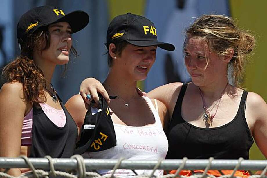 Unidentified students react as they arrive to the Mocangue naval base in Rio de Janeiro, Saturday, Feb. 20, 2010. After clinging to life rafts in high seas for up to 16 hours, more than five dozen students and crew rescued from the Canadian sailing ship Concordia that sank in the Atlantic began arriving in Rio de Janeiro on Saturday. Photo: Felipe Dana, AP
